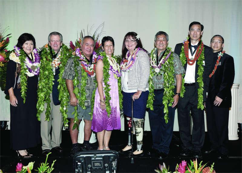 UHM alumni wearing leis