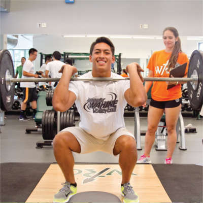 Student weightlifting at UHM rec center